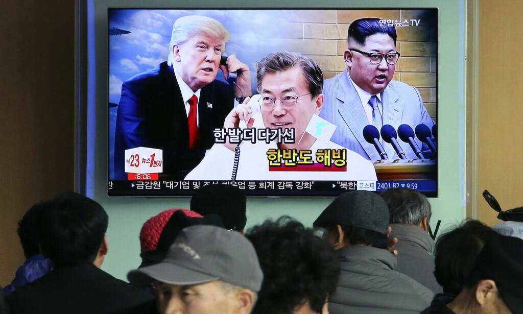 SEOUL: En TV-skjerm i Seoul viser bilder av president Donald Trump, Sør-Koreas president Moon Jae-in og Nord-Koreas leder Kim Jong-un. Foto: Ahn Young-joon / AP / NTB scanpix