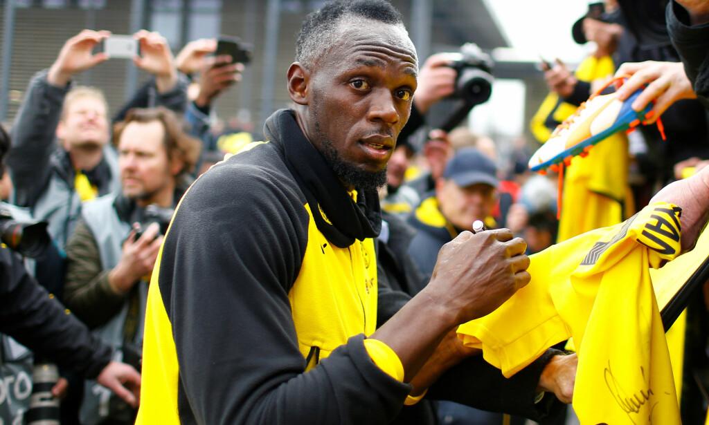 POPULÆR MANN: Mange hadde møtt opp for å møte Usain Bolt. Foto: REUTERS/Thilo Schmuelgen/NTB Scanpix