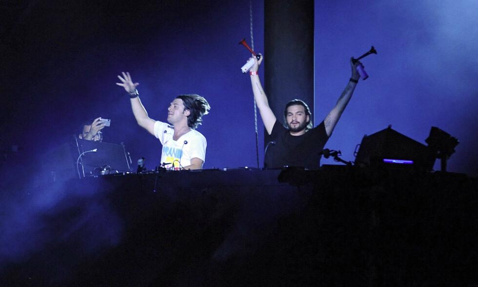 GJENFORENT: Den svenske supertrioen Swedish House Mafia spilte sammen for første gang på fem år i natt. Her under en konsert i Frankrike i 2009. Foto: NTB Scanpix