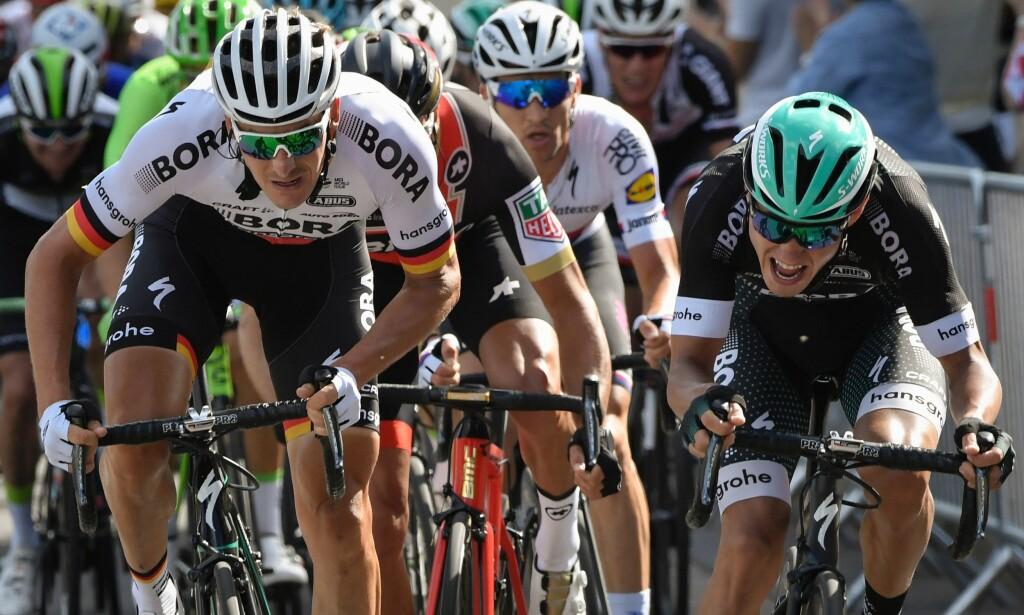 FORT: Den tyske toppsyklisten Marcus Burghardt (foran til venstre) klarte å passere 130 i Tour de France. Foto: Berhnard Papon/AFP/NTB Scanpix