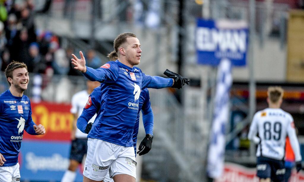 STORSPILTE: Michael Karlsen jubler etter en av to scoringer mot Stabæk. Foto: Ned Alley / NTB scanpix