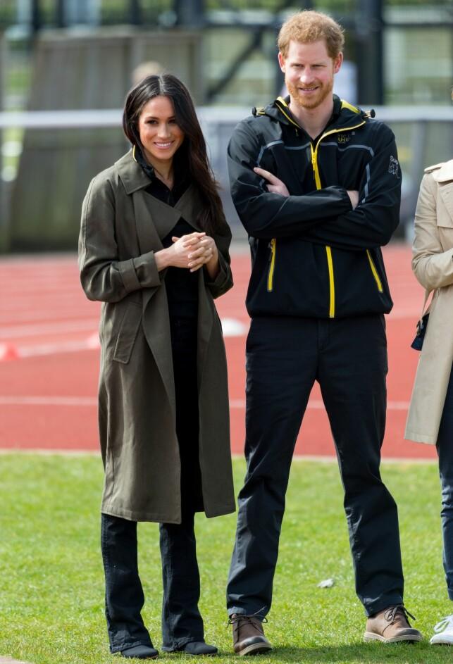 AVSLAPPET: Prins Harry og hans forlovede Meghan Markle gikk for en avslappet stil under fredagens sportsevent. Foto: NTB Scanpix.