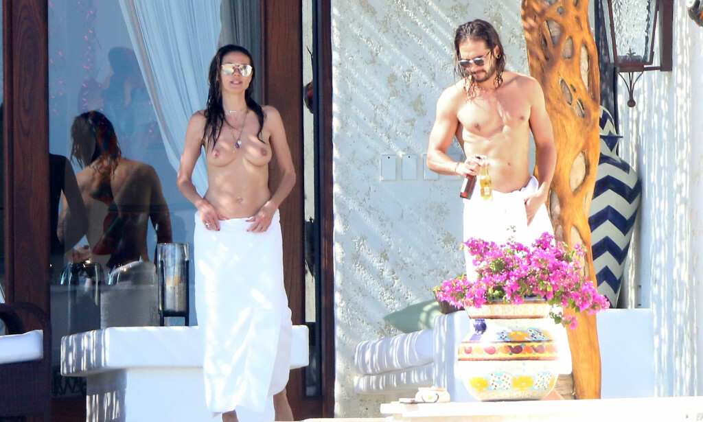 AVSLAPPET DUO: Kjæresteparet Heidi Klum og Tom Kaulitz bryr seg ikke om paparazzi-fotografenes kameralinser. Foto: NTB Scanpix