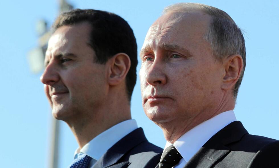 NÆRE ALLIERTE: Vladimir Putin og hans nære allierte, Syrias president Bashar al-Assad. Foto: Mikhail Klimentjev / Sputnik / AP / NTB Scanpix