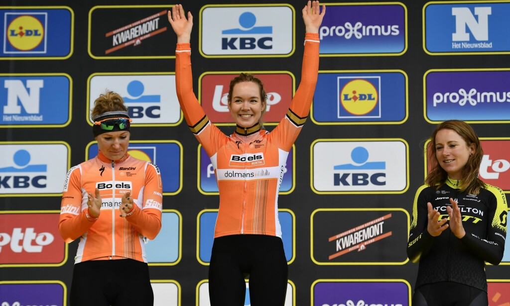 (From L) Second-placed Dutch rider Amy Pieters, winner Dutch rider Anna van der Breggen and third-placed Dutch rider Annemiek Van Vleuten celebrate on the podium after the women elite race of the 'Ronde van Vlaanderen - Tour des Flandres - Tour of Flanders' one day cycling race, 150,9km with start and finish in Oudenaarde, on April 1, 2018. / AFP PHOTO / BELGA AND Belga / DIRK WAEM / Belgium OUT