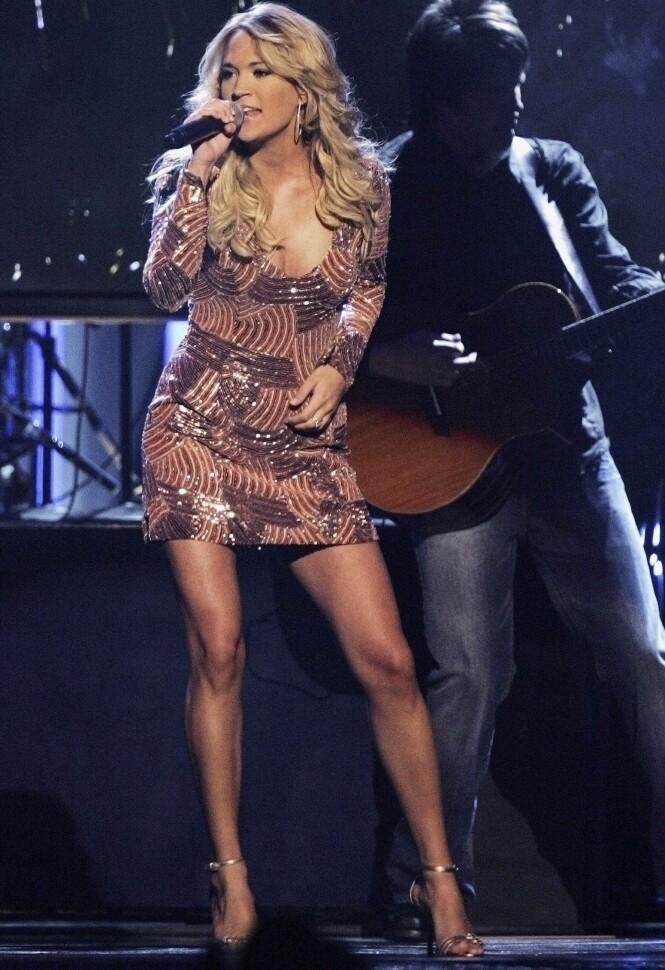 VERDENSSTJERNE: Carrie selger ut arenaer verden over, og har fenget millioner med sin tidvis kristne countrymusikk. Foto: NTB scanpix