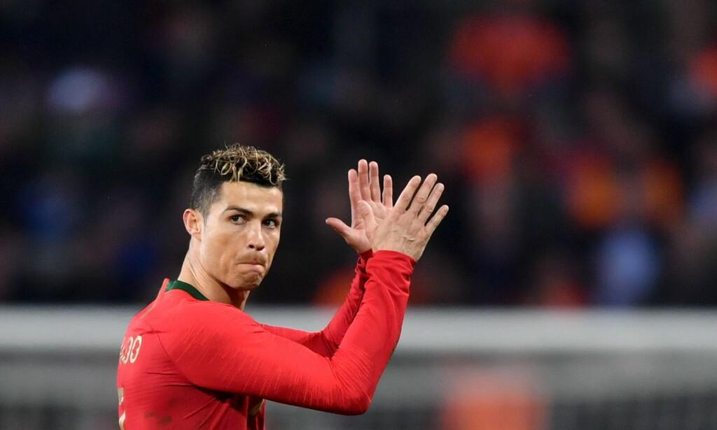 VM-KLAR: Cristiano Ronaldo og regjerende europamester Portugal er blant favorittene når VM sparkes i gang i sommer. Foto: AFP PHOTO / Fabrice COFFRINI