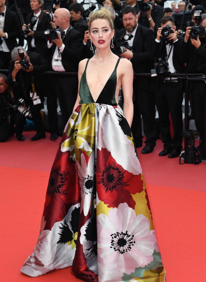 <strong>KJOLEKRITIKK:</strong> Amber Heards spesielle Valentino-kjole på Cannes-festivalen får hard medfart av Daily Mails lesere. Foto: NTB scanpix