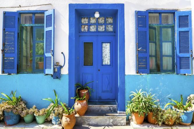 LYSEBLÅ-TURKISE FARGER: Den herlig lyseblå-turkise fargen ser du mye av på denne øya. FOTO: NTB Scanpix