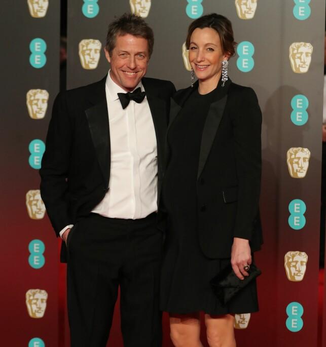 NYGIFT: Hugh Grant og hans kone Anna Eberstein under British Academy Film Awards tidligere i år. Foto: NTB Scanpix