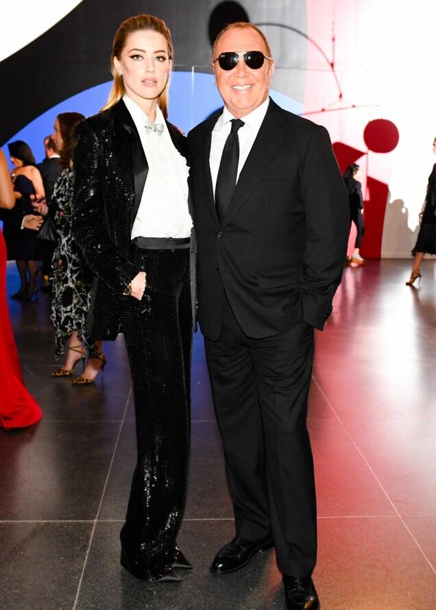 GLITRET: Skuespiller Amber Heard sammen med designer Michael Kors. Foto: Zach Hilty/ BFA/ REX/Shutterstock/ NTB scanpix