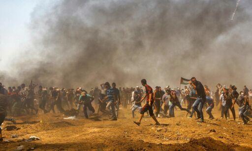 image: Rett etter at Mohammed tok dette bildet, ble han skutt i beinet