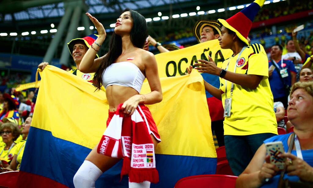 FÅR MYE OPPMERKSOMHET: Getty Images måtte rykke ut og beklage en bildeserie av kvinnelige fotballfans. The Fan Girl vil endre det bildet media tegner av kvinner på fotballkamp. Her fra kampen mellom Polen og Colombia. Foto: NTB Scanpix