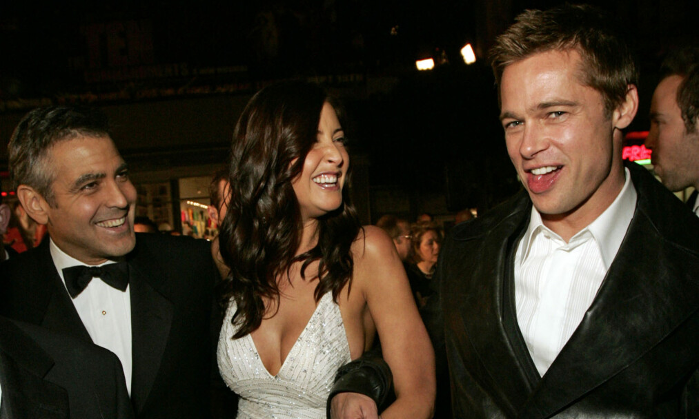 IKKE KLAR: Ifølge kilder nær Brad Pitt skal filmkjekkasen ikke være klar for noe nytt forhold enda. Her med kompisen George Clooney og skuespiller Lisa Snowdon (Clooneys daværende kjæreste) på en filmpremiere i 2004. Foto: AP/ NTB Scanpix
