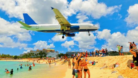 <strong>SPEKTAKULÆRT:</strong> Innflygingen går rett over Maho-stranda, og er et yndet sted for flykikkere. Foto: Shutterstock / NTB Scanpix