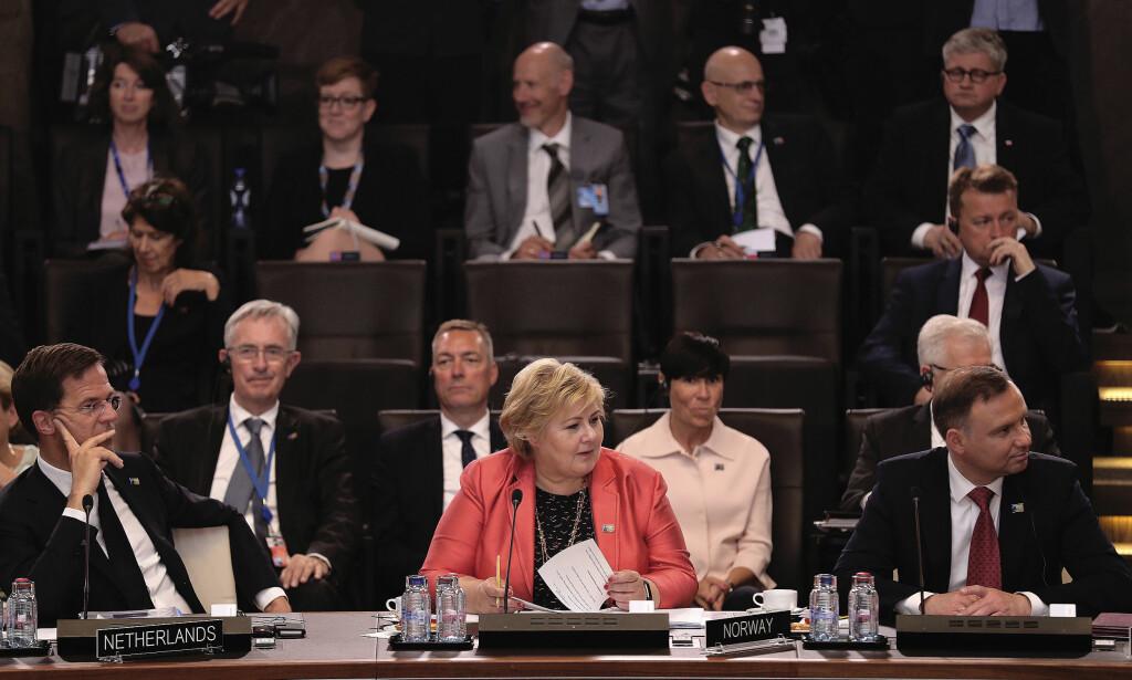 FRYKTET RETORIKK: Erna Solberg oppfattet dagens Nato-møte som sømmelig, og fortalte at Donald Trumps retorikk ikke var på langt nær like tøff som den var tidligere i dag. Foto: Torbjørn Kjosvold / Forsvaret / NTB scanpix
