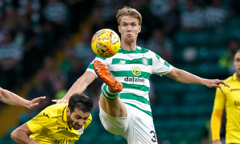 Alashkert's Artak Grigoryan (left) and Celtic's Kristoffer Ajer (right) battle for the ball during the UEFA Champions League match at Celtic Park, Glasgow.