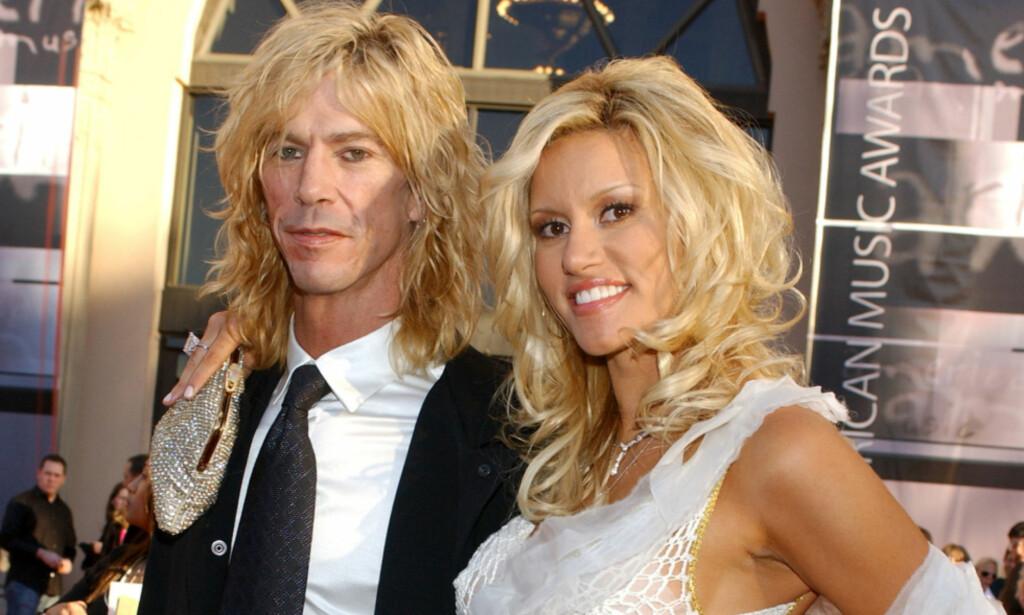 GIFT: Duff McKagan og kona Susan Holmes giftet seg i 1999. Paret har to døtre og kombinerer et rolig familieliv med rockelivet. Foto: NTB Scanpix