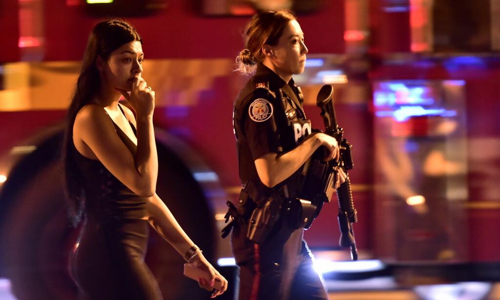 DREPT: To personer ble drept i skytingen i Greektown i Toronto søndag kveld. Gjerningsmannen er ifølge politiet død. Foto: Frank Gunn / The Canadian Press via AP / NTB scanpix