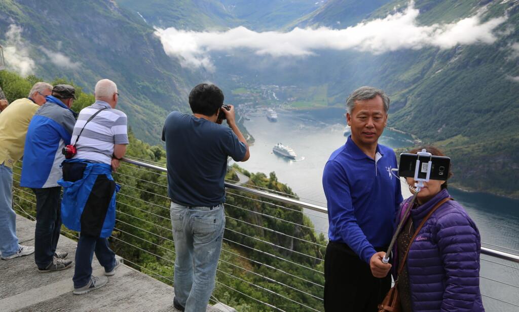 Turistrekord: Turistantallet sprenger alle rekorder i Geiranger. Nå går fokuset fra «flere turister» til «bedre turister». Ellers kan verdensarvstatusen ryke. Foto: Odd Roar Lange/The Travel Inspector