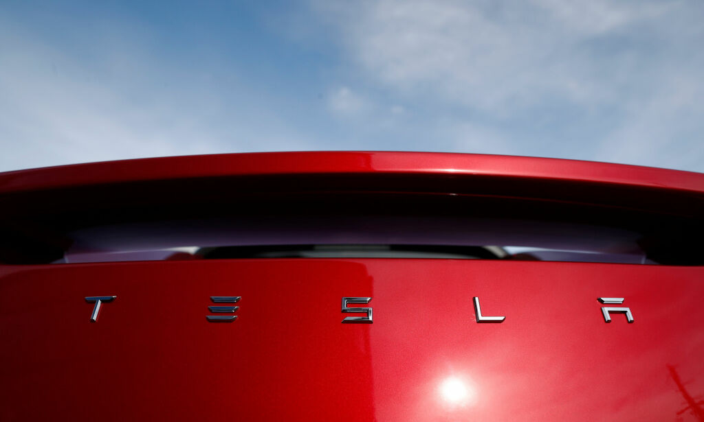 FILE- In this April 15, 2018, file photo, the sun shines off the rear deck of a roadster on a Tesla dealer's lot in the south Denver suburb of Littleton, Colo. Tesla is suing a former employee at its Nevada battery factory alleging that he hacked into the manufacturing computers and disclosed confidential trade secrets. The federal lawsuit filed Wednesday, June 20, contends that Martin Tripp of Sparks, Nev., also made false claims to the media about information he stole, including claims that the company used punctured battery cells in the Model 3 electric car. (AP Photo/David Zalubowski, File)