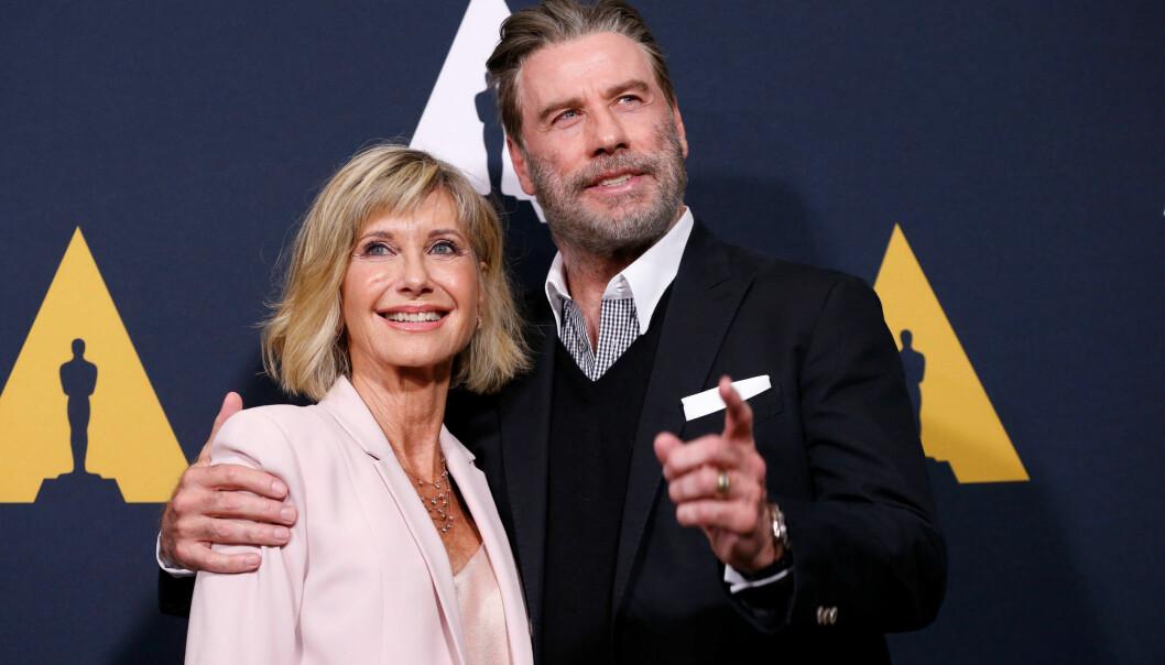 «WE GO TOGETHER»: Olivia Newton-John (69) og John Travolta (64) kom sammen til gjenforeningsfesten. Foto: Reuters / NTB Scanpix