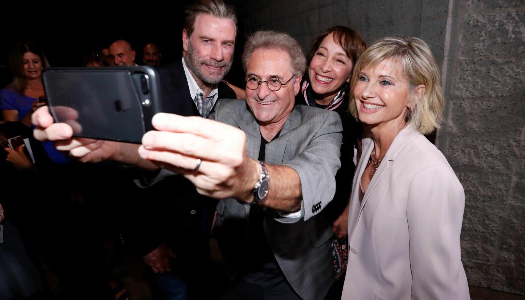 ELDRE: John Travolta og Olivia Newton-John sammen med skuespiller Barry Pearl (68), kjent for rollen som Doody, og Didi Conn (67) - som spilte karakteren Frenchie. Foto: Reuters / NTB Scanpix