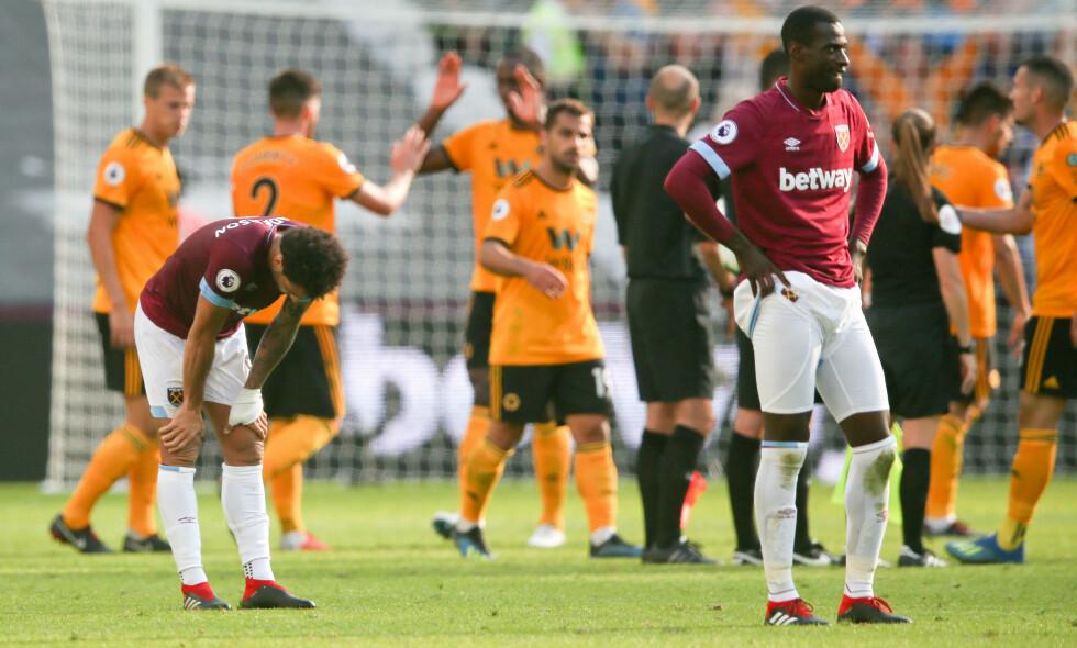 FORTVILER: West Ham-spillerne er langt nede etter nok et tap i Premier League. Foto: Andrew Fosker/BPI/REX/Shutterstock/NTB Scanpix
