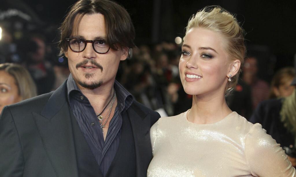DEN GANG DA: Johnny Depp og Amber Heard var et av Hollywoods mest omtalte par. Så gikk alt galt. Her avbildet sammen i 2011. Foto: AP / NTB Scanpix