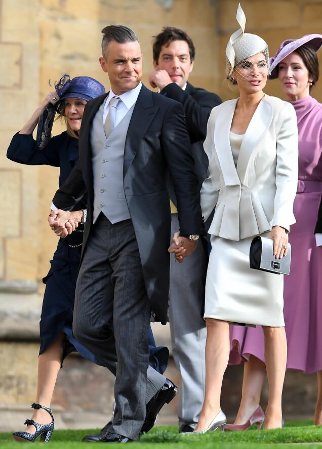 <strong>POPSTJERNE:</strong> Robbie Williams ankom hånd i hånd med kona Ayda Field. Foto: NTB scanpix