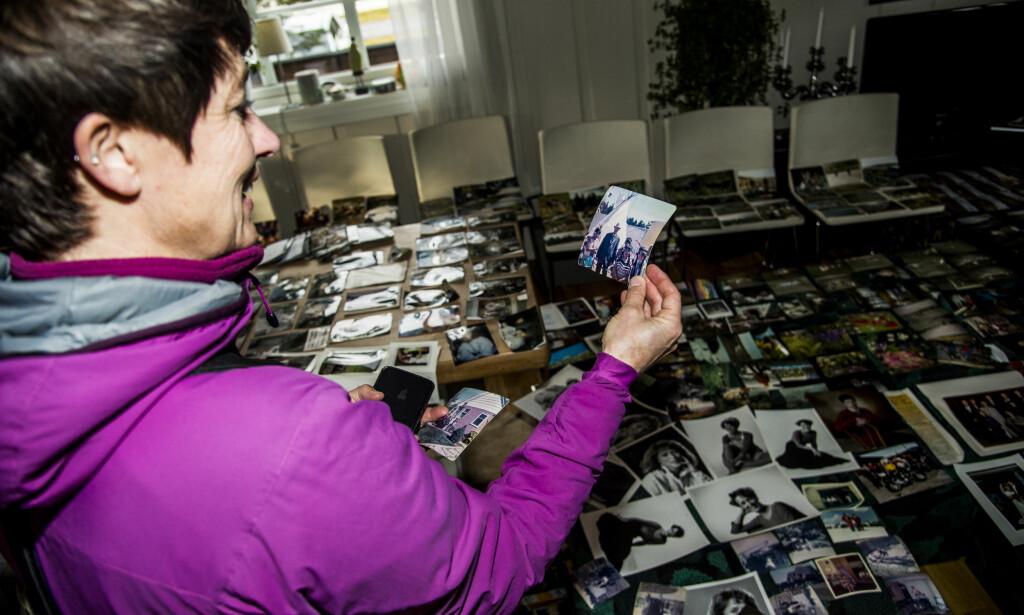 BILDENE: Naboer og venner passet på at alle bildene ble lagt ut til tørk. Foto: Andreas Lekang / Dagbladet