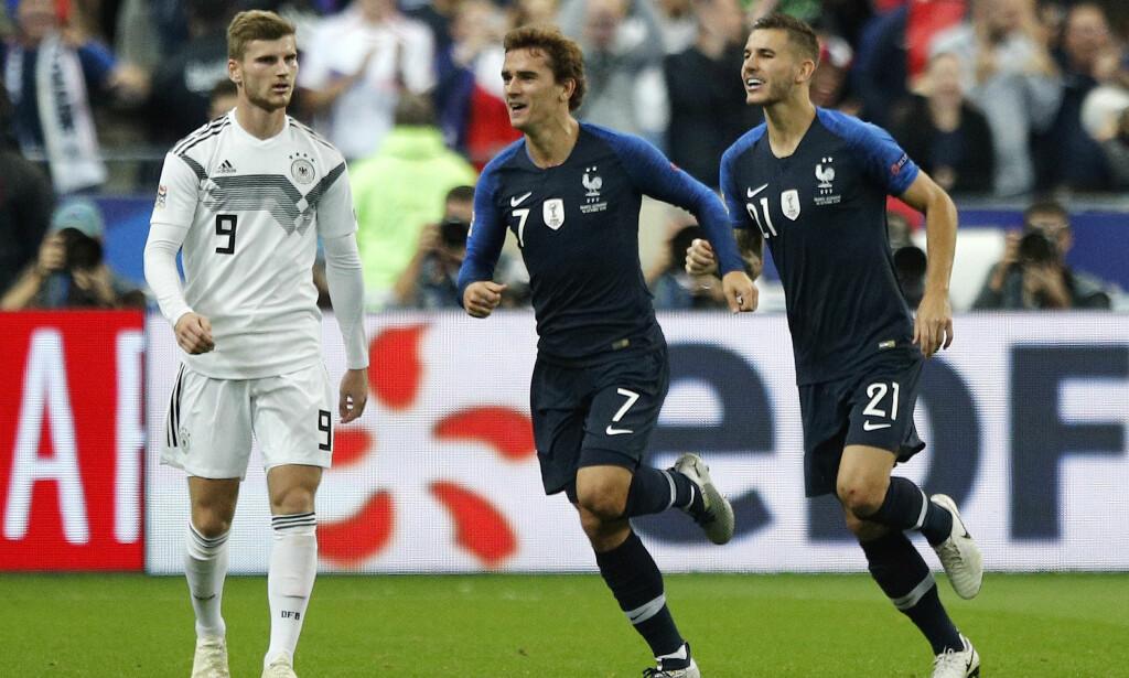 SENKET AV GRIEZMANN: Antoine Griezmann (i midten) scoret begge målene til Frankrike da de slo Tyskland i Nations League, tirsdag. Til venstre Tysklands Timo Werner. Til høyre Lucas Hernandez. FOTO: AP Photo/Francois Mori