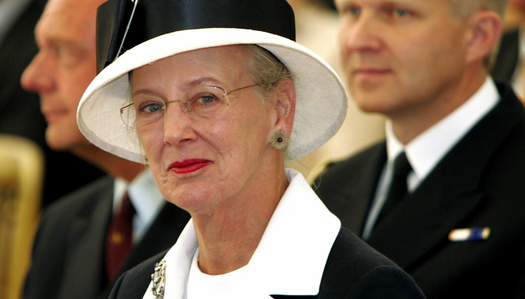 BEKLAGET: Skilsmissen var såpass ukonvensjonelt at dronning Margrethe og ektemannen, den nå avdøde prins Henrik, innledet kunngjøringen med en beklagelse. Foto: NTB Scanpix