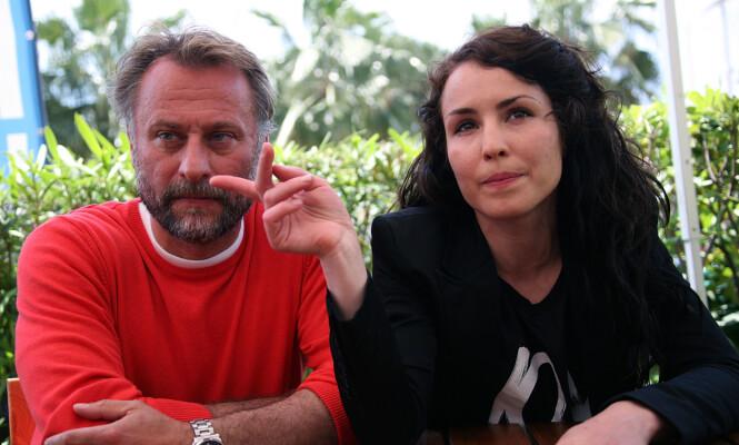 STJERNESKUESPILLER: Michael Nyqvist var å se i en rekke internasjonale produksjoner, men var også godt kjent for det han gjorde hjemme i Sverige. Her er han fotografert sammen med Noomi Rapace i Cannes, i forbindelse med utgivelsen av «Menn som hater kvinner». Foto: NTB scanpix