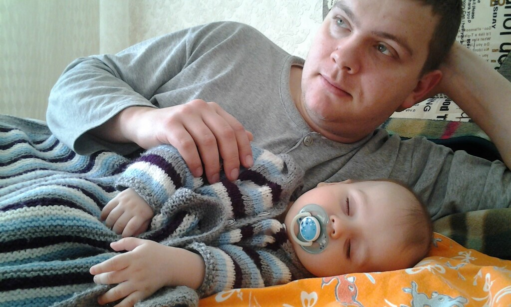 HOME IN ODESSA: Dmitry Kravchenko at home with his son Timofei (1).