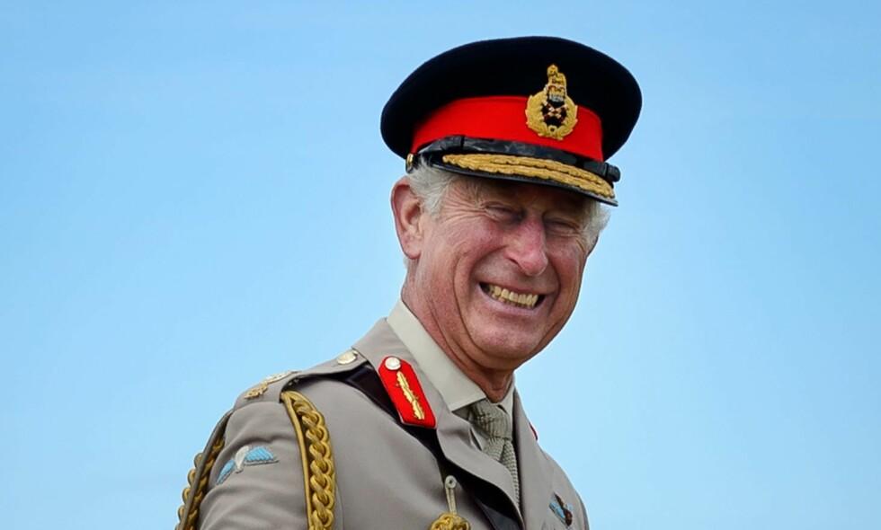 LYKKELIG JUBILANT: Prins Charles fyller hele 70 år i dag, og det feires med et nytt bilde av han og familien. Hans foreldre er derimot ikke å se på fotografiet. Foto: NTB scanpix