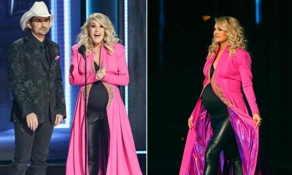 SNART TOBARNSMOR: Onsdag ledet country-stjernene Brad Paisley og Carrie Underwood CMA Awards i Nashville, og fra scenen røpet hun babykjønnet på sitt ufødte barn. Foto: NTB Scanpix