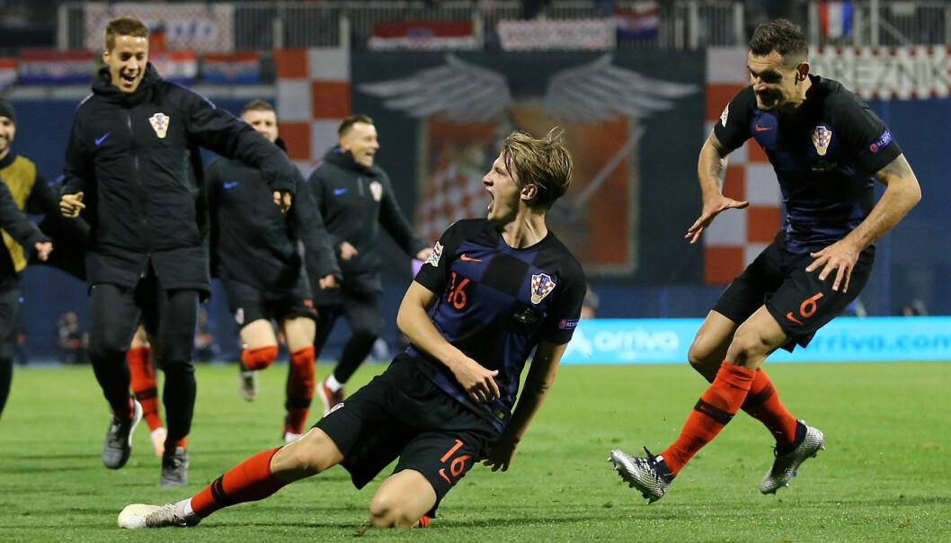 <strong>JUBEL:</strong> Hele Kroatias lag og benk jublet hemningsløst da Tin Jedvaj scoret det avgjørende målet på overtid mot Spania. Foto: NTB scanpix