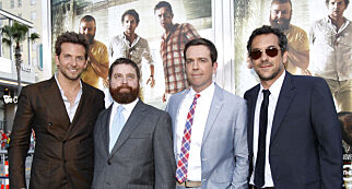 """Director of the movie Todd Phillips (R) poses with cast members (from L-R) Bradley Cooper, Zach Galifianakis and Ed Helms at the premiere of """"The Hangover Part II"""" at Grauman's Chinese theatre in Hollywood, California May 19, 2011. The movie opens in the U.S. on May 26.  REUTERS/Mario Anzuoni (UNITED STATES - Tags: ENTERTAINMENT)"""