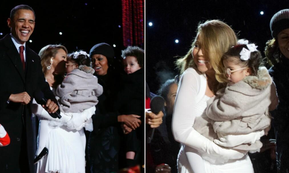 FLAU EPISODE: Michelle Obama fikk holde Mariah Careys sønn mens de danset sammen på scenen under seremonien «National Christmas Tree Lighting» i 2013. Det angret hun bittert på. Foto: NTB Scanpix