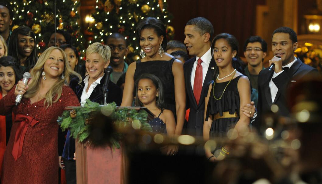 FLERE MØTER: Mariah Carey har møtt Michelle og Barack Obama ved flere anledninger. Her under et juleevent i Washington i 2010 - før popstjernens barn var født. Foto: NTB Scanpix.