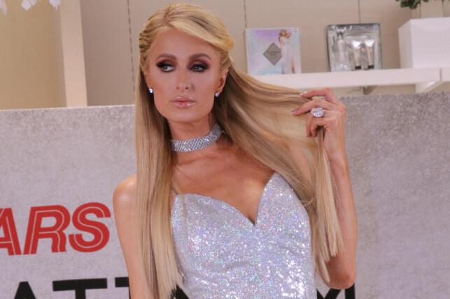 ENORM DIAMANT: Den eksklusive ringen har vært et fast innslag på Paris Hiltons finger de siste ti månedene, men nå må hun levere den tilbake. Foto: NTB Scanpix