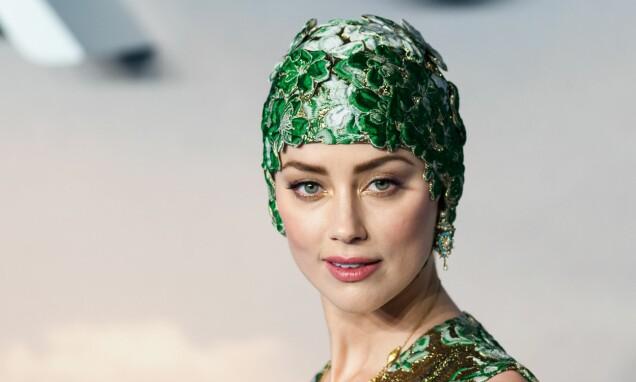 <strong>SLÅENDE VAKKER:</strong> Amber Heard er av typen som kan få alt til å se bra ut – til og med en badehette, viser det seg. FOTO: NTB Scanpix