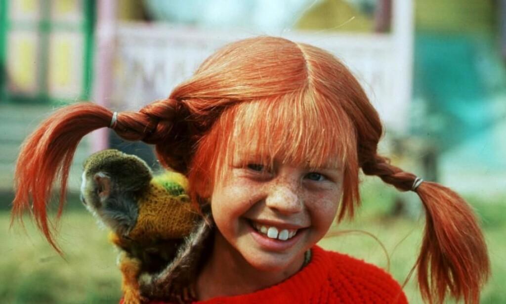 KJENT OG KJÆR KARAKTER: Inger Nilsson var bare åtte år da hun fikk rollen som Pippi Langstrømpe og ble kjent verden rundt. Her i karakter, med apen «Herr Nilsson». Foto: Aftonbladet Bild / NTB Scanpix