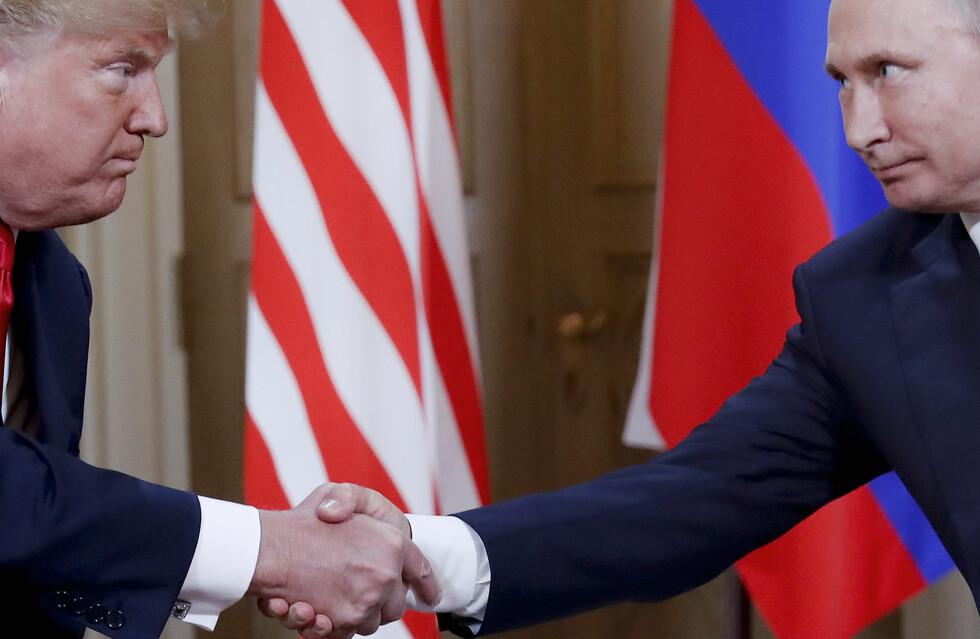 SAMMEN: Men i hvert sitt hjørne. Donald Trump og Vladimir Putin. De har preger året 2018. Foto: AP / NTB Scanpix