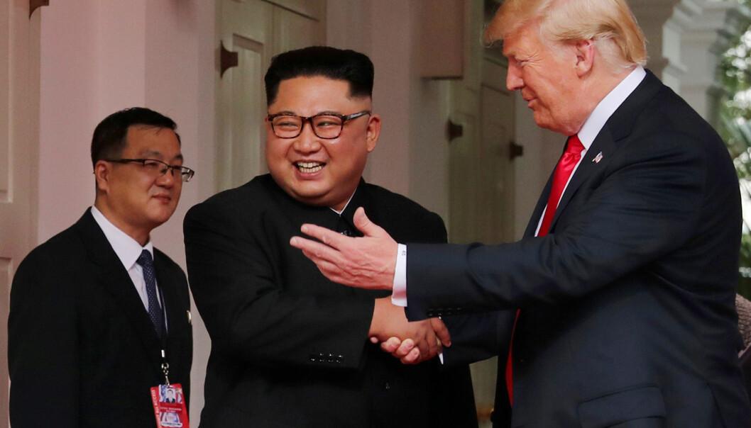 <strong>MØTTES:</strong> USAs president Donald Trump og Nord-Koreas leder Kim Jong-un under deres første og hittil eneste møte i Singapore i juni i 2016. Foto: Jonathan Ernst / Reuters / NTB Scanpix