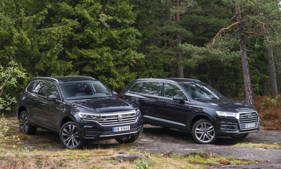 NY UTGAVE: VW Touareg (t.v) har kommet i ny utgave fra innerst til ytterst. Betyr det at den spiser den ikke alt for gamle Q7 til alle måltider? Vi har testet dem mot hverandre. Alle foto: Jamieson Pothecary / Autofil