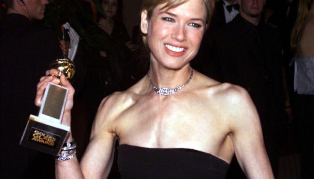<strong>MÅTTE FIKSE TENNENE:</strong> Renée Zellweger lot Hugh Grant - og «hele» Hollywood i salen - vente mens hun var på toalettet. Foto: Reuters/ NTB scanpix