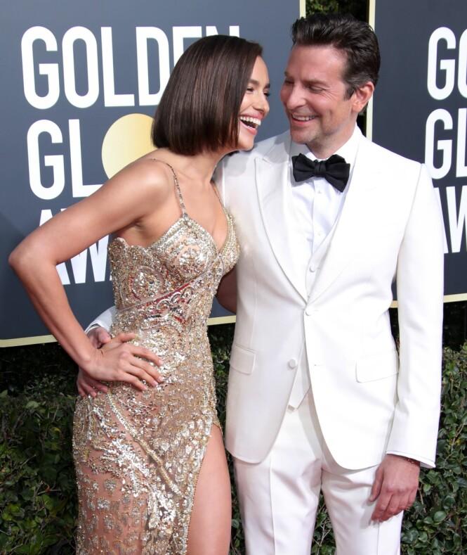 STRÅLTE SAMMEN: Irina Shayk og kjæresten Bradley Cooper så nærmest nyforelsket ut på den røde løperen under årets Golden Globe. Foto: NTB scanpix