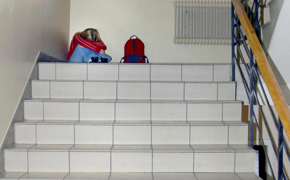 STORT PROBLEM: Ca 50 000 barn og unge i grunnskolen utsettes daglig for mobbing, skriver kronikkforfatteren. Foto: NTB Scanpix